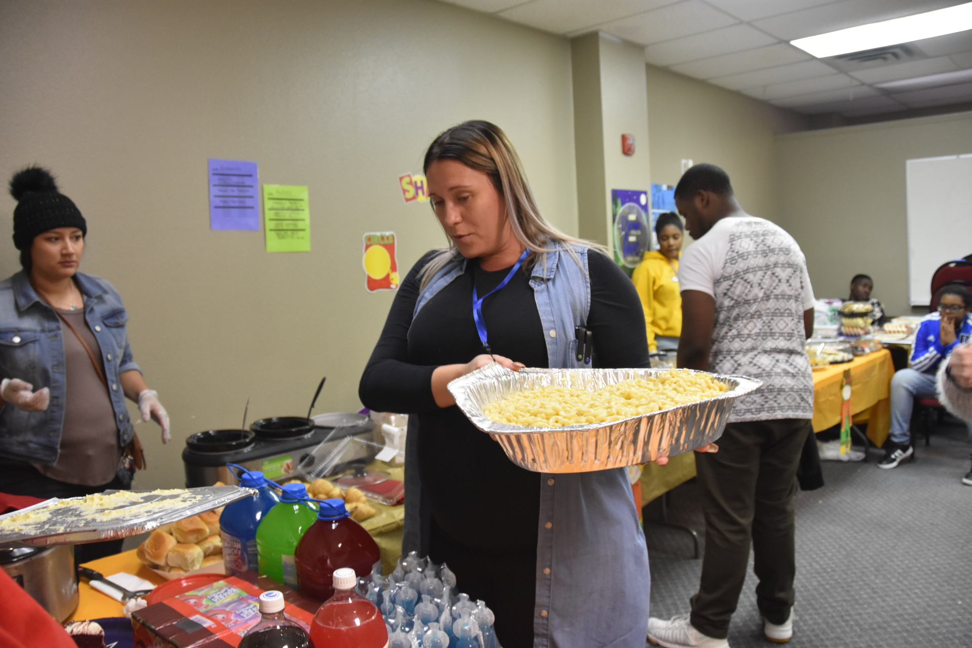 Mrs. Amanda Serving Mac and Cheese for Thanksgiving